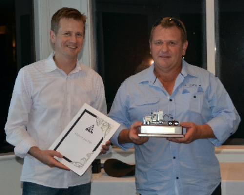 Atlas Iron Managing Director Ken Brinsden (left) with winner Stuart Foster, road train driver